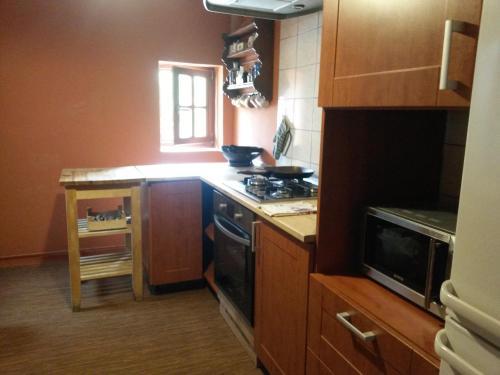 A kitchen or kitchenette at Relax Apartmán Buštěhrad