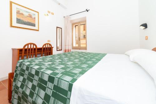 Letto o letti in una camera di San Francesco Heritage Hotel