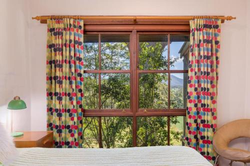 A bed or beds in a room at Friday Creek Retreat