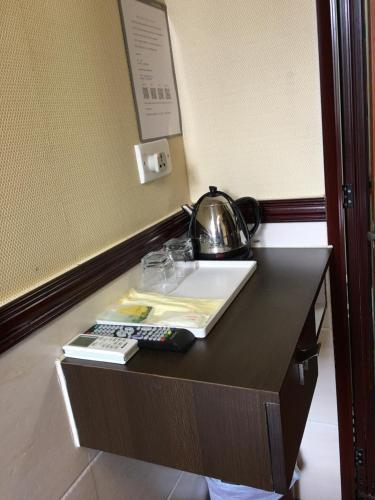 A kitchen or kitchenette at Hang Ho Hostel