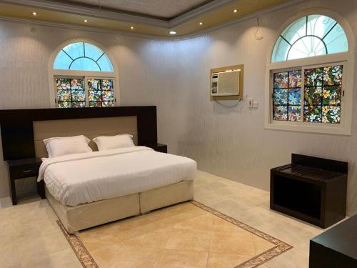 Cama ou camas em um quarto em Masaken alkenan