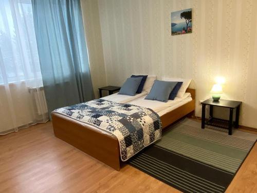 Кровать или кровати в номере Hotel Voyage Vaskelovo