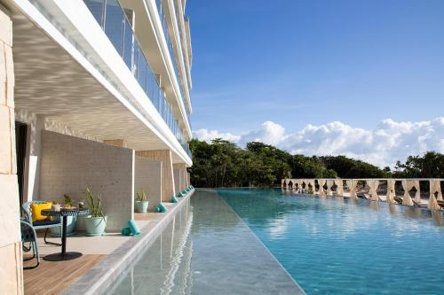 The swimming pool at or near Palmaïa - The House of AïA Wellness Enclave All Inclusive