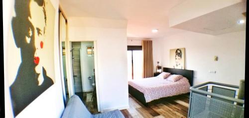 Un ou plusieurs lits dans un hébergement de l'établissement Atico Triana