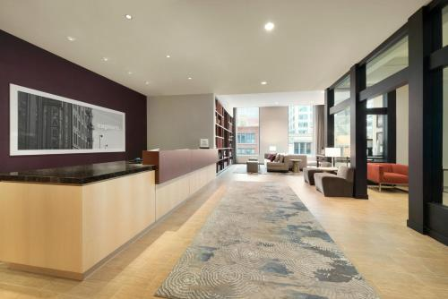 A seating area at Homewood Suites by Hilton Chicago Downtown West Loop