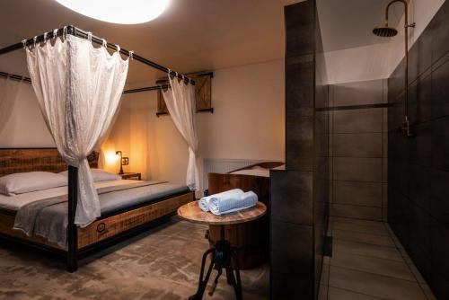 Postel nebo postele na pokoji v ubytování Penzion Mara - Pivný Wellness