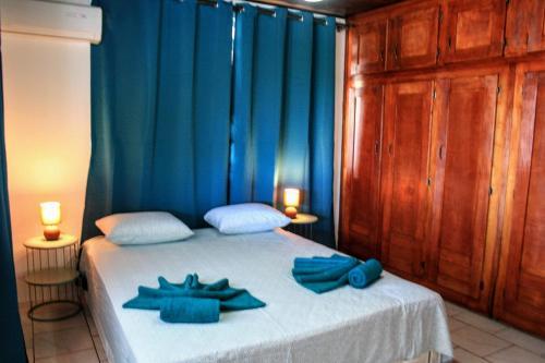 Cama ou camas em um quarto em TAHITI - Fare Temahana