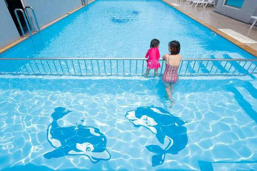 The swimming pool at or near Blue Orchids Hotel