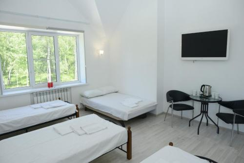A bed or beds in a room at Apart-Hotel Domodedovo