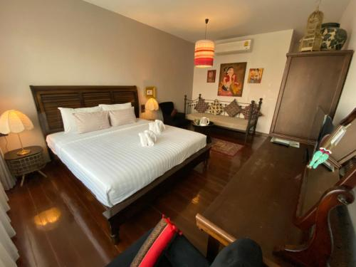 A bed or beds in a room at See You Soon, Chiang Mai