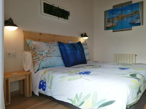 A bed or beds in a room at Vila De Premiá