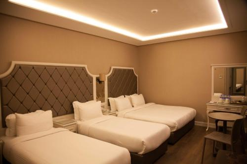 A bed or beds in a room at Miss Istanbul Hotel & Spa