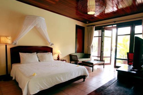 Un ou plusieurs lits dans un hébergement de l'établissement Lang Co Beach Resort