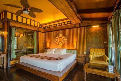 Ein Bett oder Betten in einem Zimmer der Unterkunft Parama Koh Chang