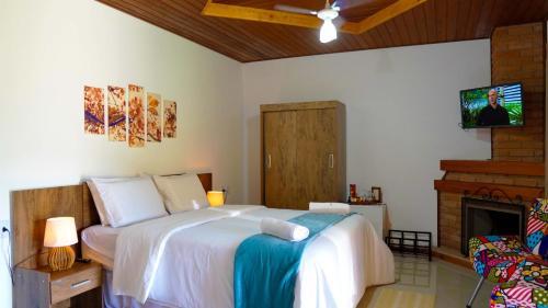 Cama ou camas em um quarto em Pousada Sitio do Visconde