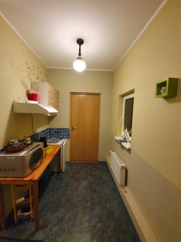 A kitchen or kitchenette at Renau