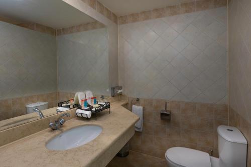 Een badkamer bij Xperience St. George Sharm El Sheikh