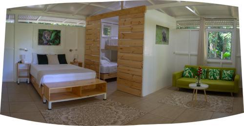 Cama o camas de una habitación en Jaguar Inn Bungalows & Hostel