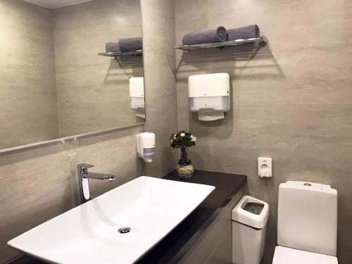 Ванная комната в Отель Мистер Жулебин