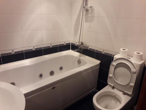 Um banheiro em ARENA PLAZA