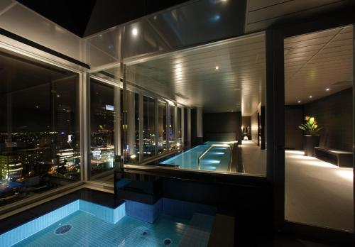 The swimming pool at or near Cross Hotel Sapporo
