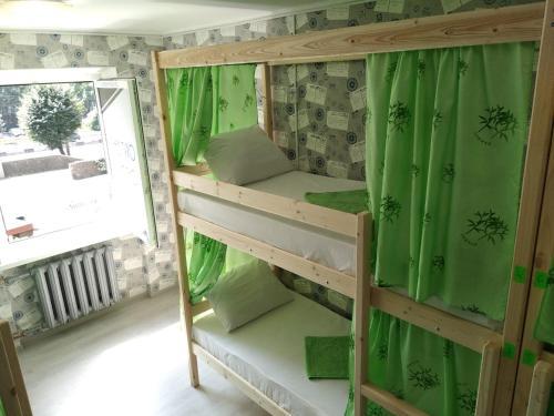 A bunk bed or bunk beds in a room at Hostel V Biblioteke
