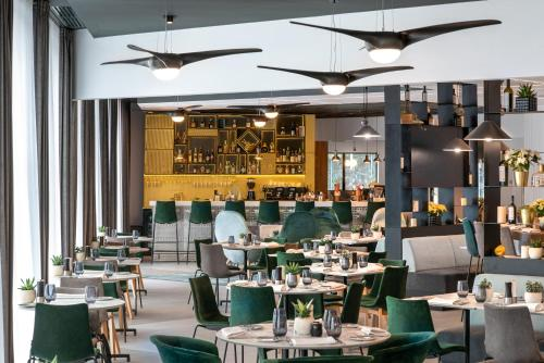 A restaurant or other place to eat at Hilton Garden Inn Bucharest Airport