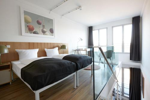 A bed or beds in a room at Generator Berlin Mitte