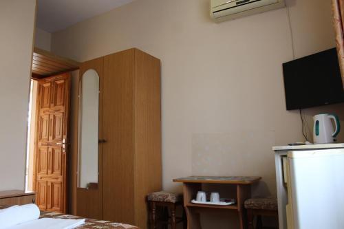 Телевизор и/или развлекательный центр в Гостевой дом «На Гоголя 16»