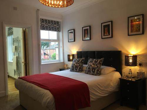 A bed or beds in a room at Holway House
