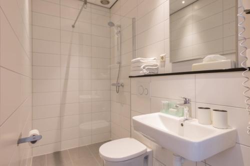 Salle de bains dans l'établissement Aquarius Hotel
