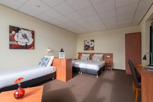 A bed or beds in a room at Aquarius Hotel