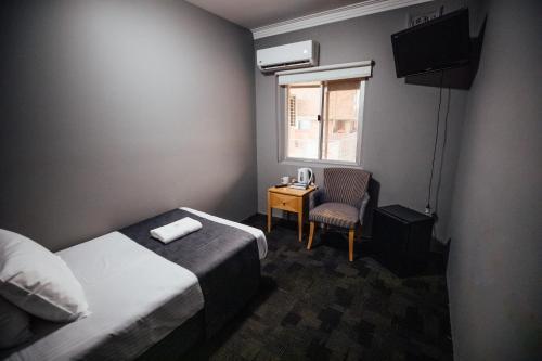 Гостиная зона в Shortland Budget Accommodation