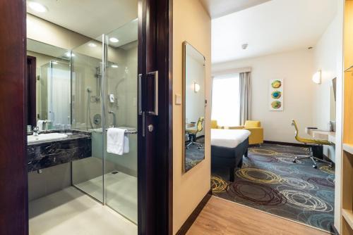 A bathroom at Ibis Styles Dragon Mart Dubai