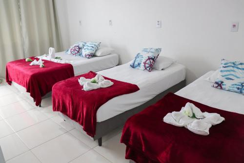 Cama ou camas em um quarto em Pousada Graff