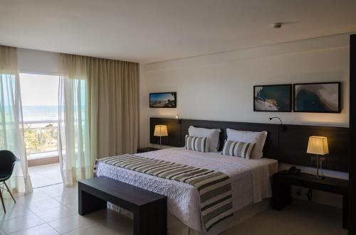 A bed or beds in a room at Crocobeach Hotel