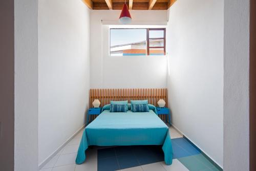 A bed or beds in a room at Casas Bioclimáticas Iter