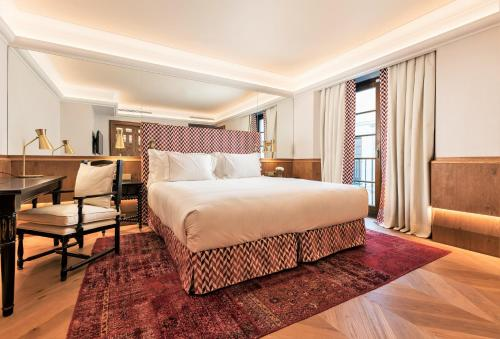 A bed or beds in a room at Palacio Solecio, a Small Luxury Hotel of the World
