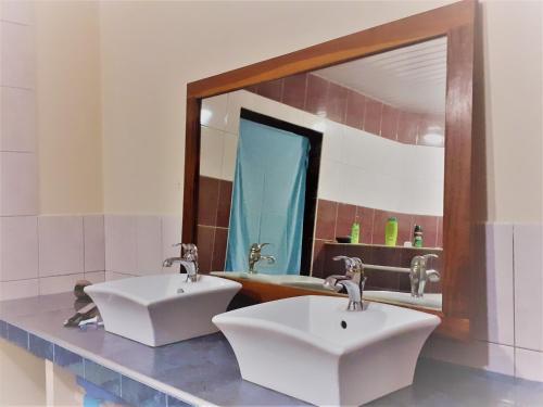 Um banheiro em TAHITI - Chambre Hautia