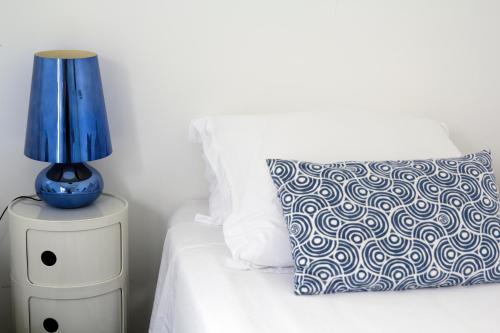 Cama o camas de una habitación en Baía das Caldeirinhas