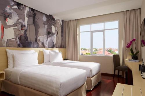 A bed or beds in a room at Four Star by Trans Hotel