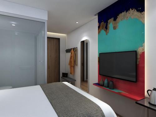 Cama o camas de una habitación en Happy Dragon Alley Hotel Beijing Tian AnMen Forbidden City