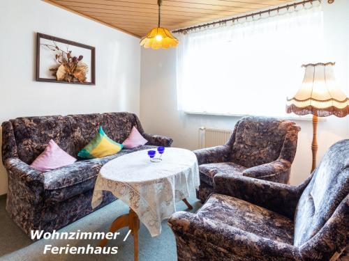 A seating area at Ferienunterkuenfte Villmann