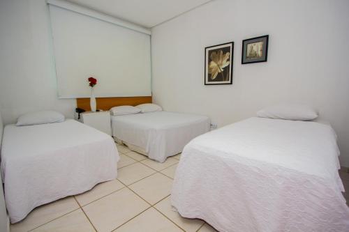 Cama o camas de una habitación en Hotel Talissa 2