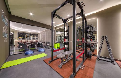 The fitness center and/or fitness facilities at Radisson Blu Leogrand Hotel