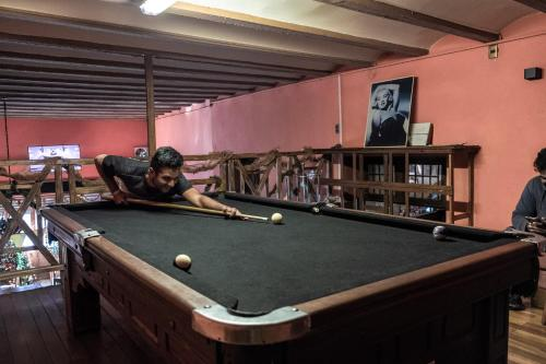 A pool table at The Adventure Brew Hostel