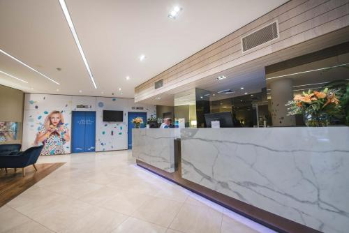 The lobby or reception area at Novotel Sydney West HQ