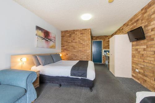 Кровать или кровати в номере Comfort Inn Dubbo City