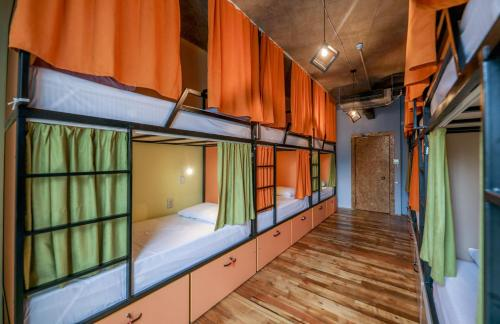 A bunk bed or bunk beds in a room at The Bridge Hostel
