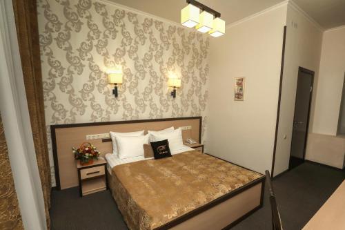 Кровать или кровати в номере Oasis Hotel